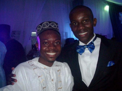 Adebayo (left), aged 21, with his friend Peter at the Centenary celebration of alma mater- King's College Lagos
